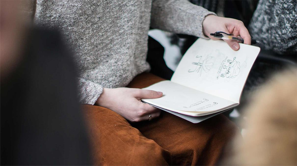 Design student draws a mockup during FUEL's On Your Mark design workshop